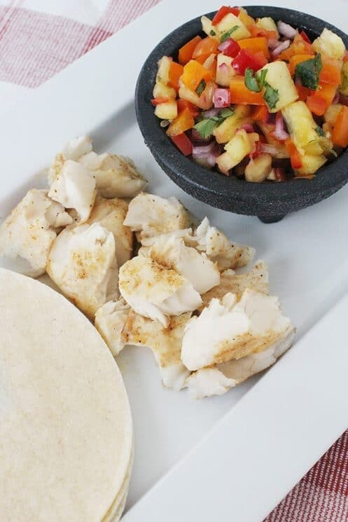 Fish Tacos that are loaded with fresh toppings and a deliciously mild fish for kids to enjoy!