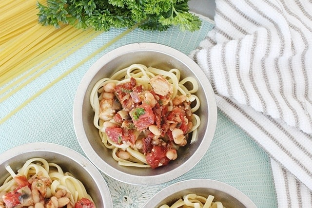 three dishes of italian chicken pasta dinner