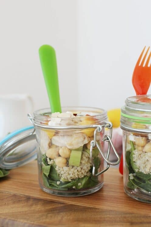Sweet and Savory Peach Quinoa Salad in jars with forks
