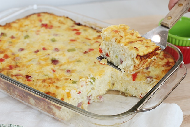 Breakfast Casserole Lifting a Slice Out of the Pan