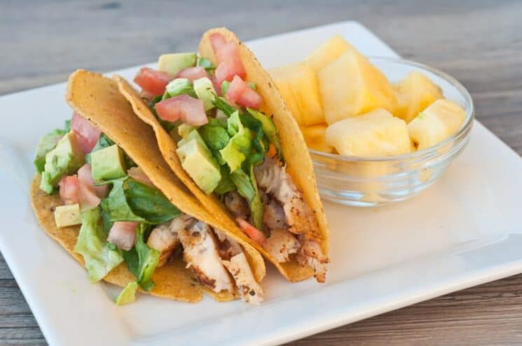 white fish tacos with avocado salsa and pineapple