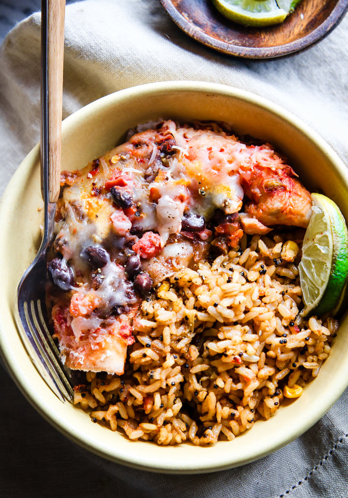 healthy bowl of fish, beans, rice and lime