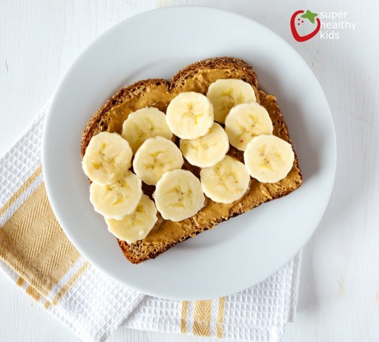 peanut butter toast with bananas on a plate