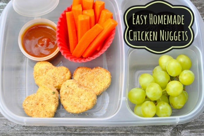 chicken nuggets fruit and veggies in a lunchbox
