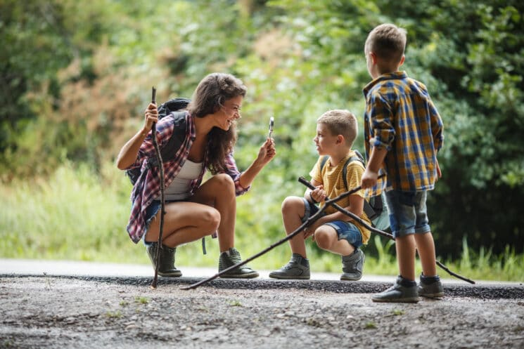 mom with kids hiking in the woods