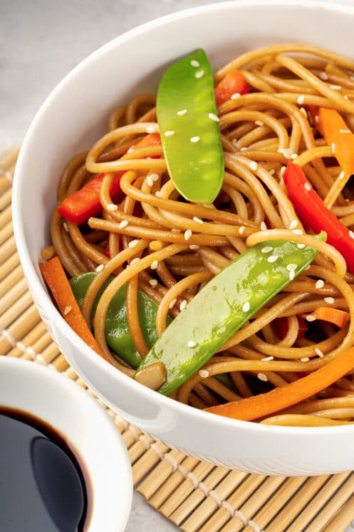 bowl of homemade lo mein with veggies garnished with sesame seeds