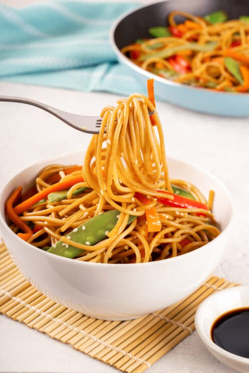 lo mein with veggies in a bowl, with a fork