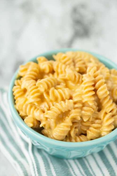 creamy homemade mac and cheese in a blue bowl
