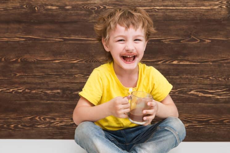 happy boy drinking chocolate milk