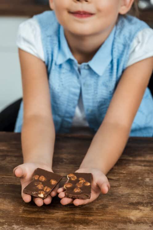 girl holding chocolate bark