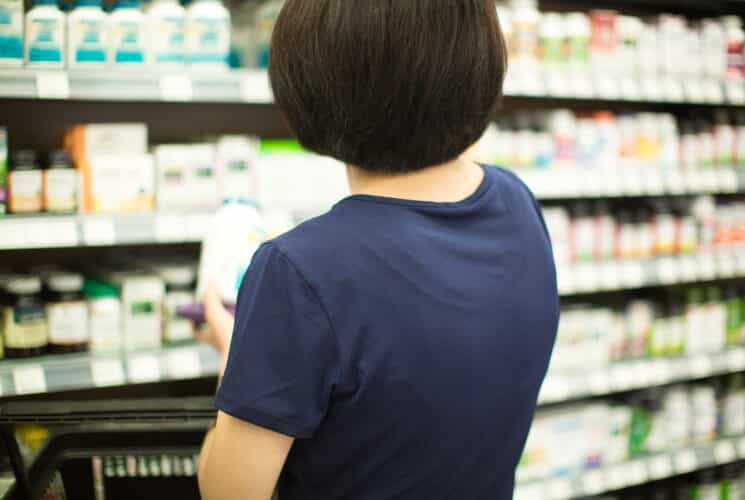 mom choosing probiotics at the store