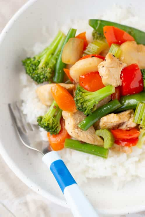 freezer meal stir fry warmed up in a bowl with rice