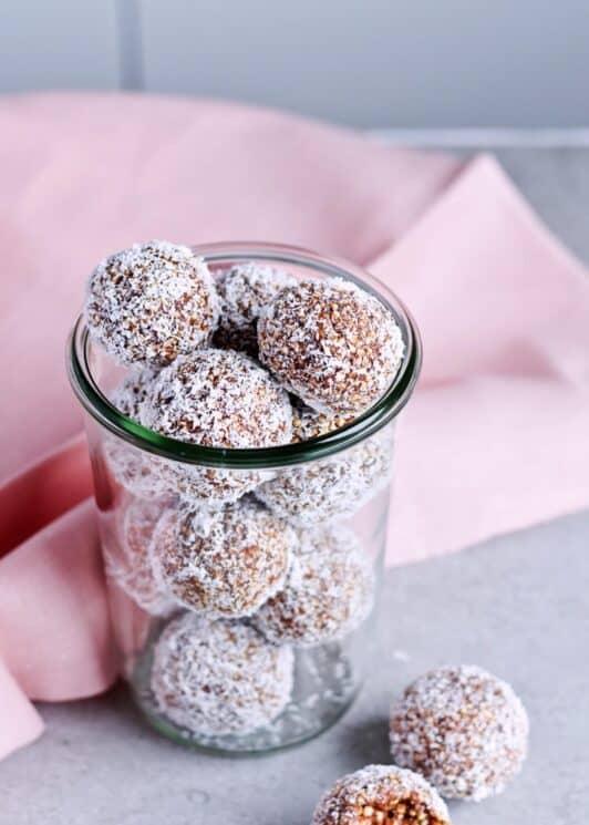 Puffed Quinoa Date energy balls in a mason jar.
