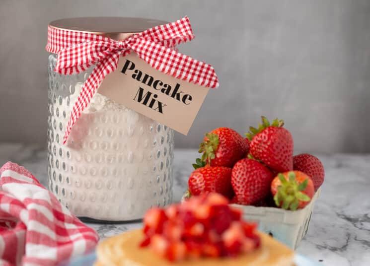 jar of homemade pancake mix with fresh berries
