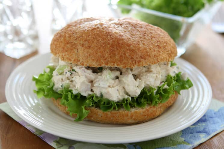 chicken salad sandwich on a bun with lettuce