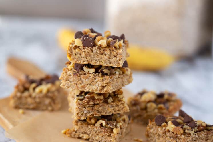 peanut butter banana bars stacked up on a piece of parchment paper