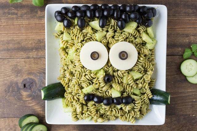 serving plate of pesto pasta shaped like Frankenstein