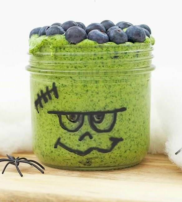 green smoothie in a glass jar decorated to look like frankenstein