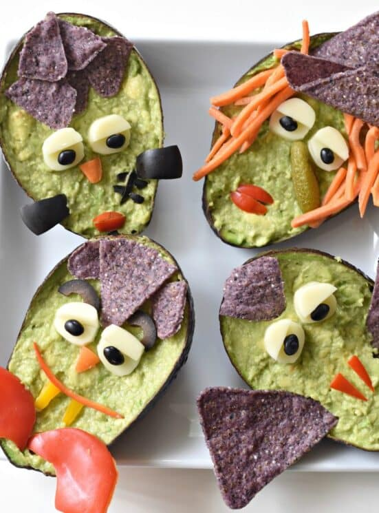guacamole served in avocado skins made up to look like monsters and witches