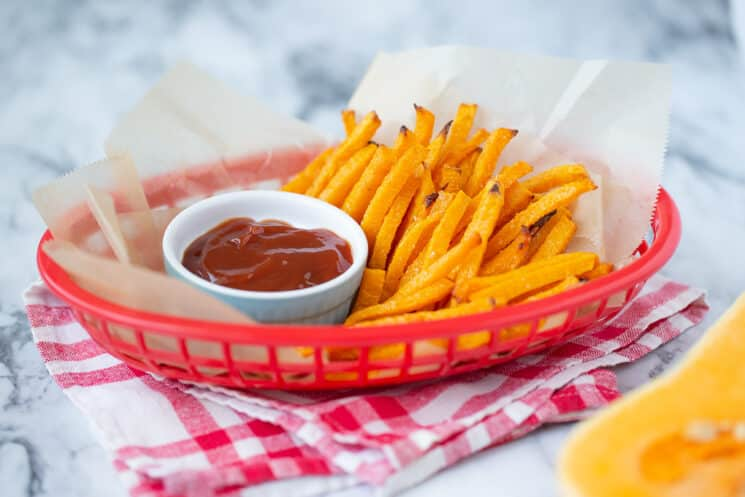butternut squash fries in a basket with ketchup for kids