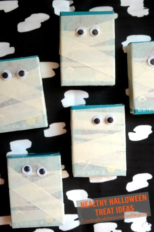 raisin boxes wrapped in masking tape to look like mummies, with googly eyes