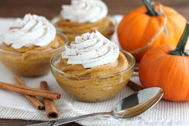 whipped pumpkin mousse in glass dishes with whipped cream
