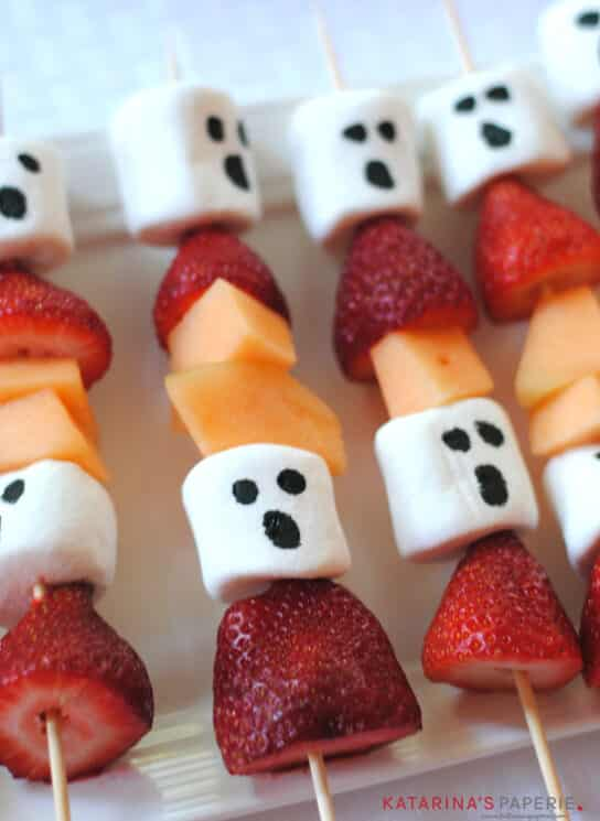 fruit kebabs with strawberries, cantaloupes, and marshmallows decorated like ghosts