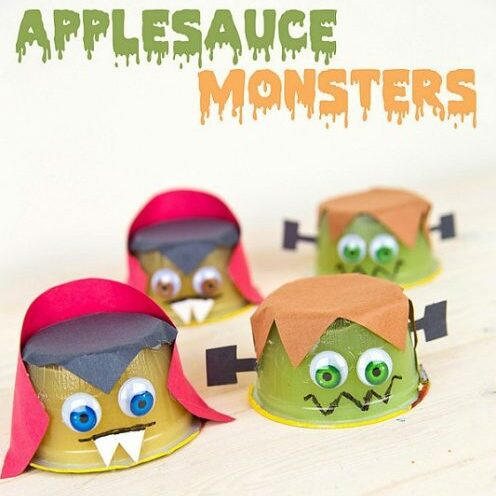 applesauce cups turned upside down and decorated like monsters