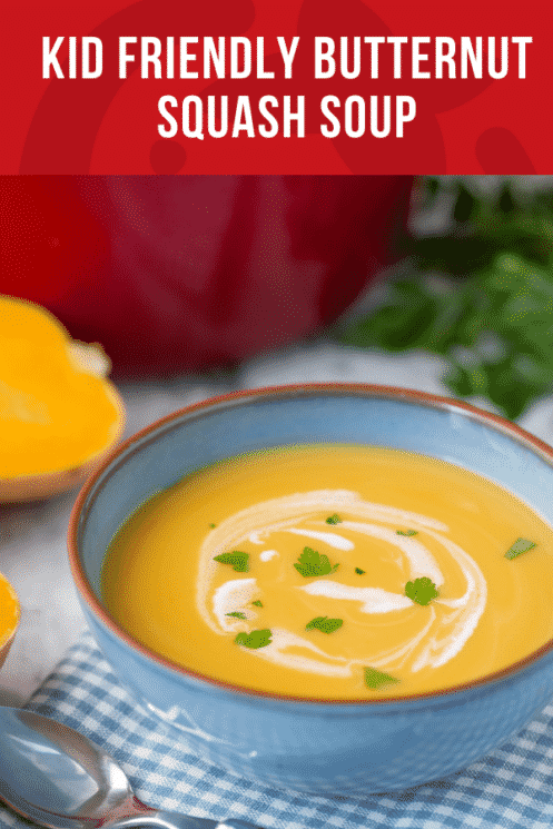 blue bowl of butternut squash soup with a swirl of cream on top