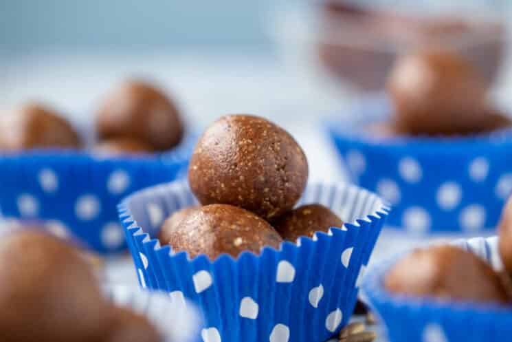 fudgy energy balls inside paper muffin liners with blue polka dots