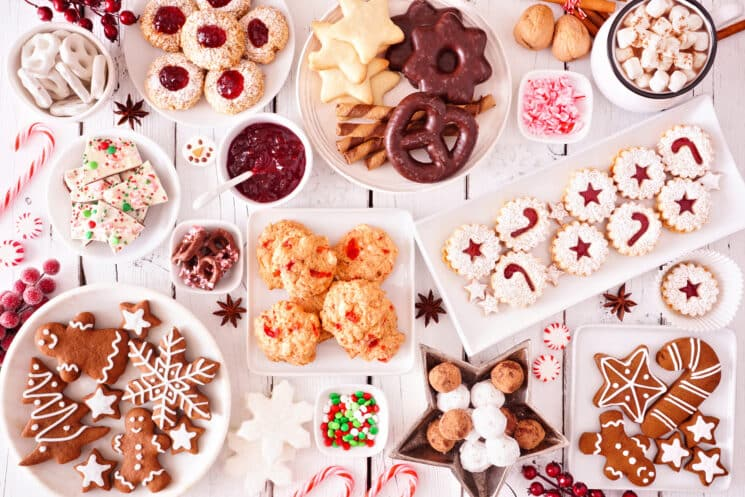 a collection of christmas cookies on a white table. This party food does not look healthy