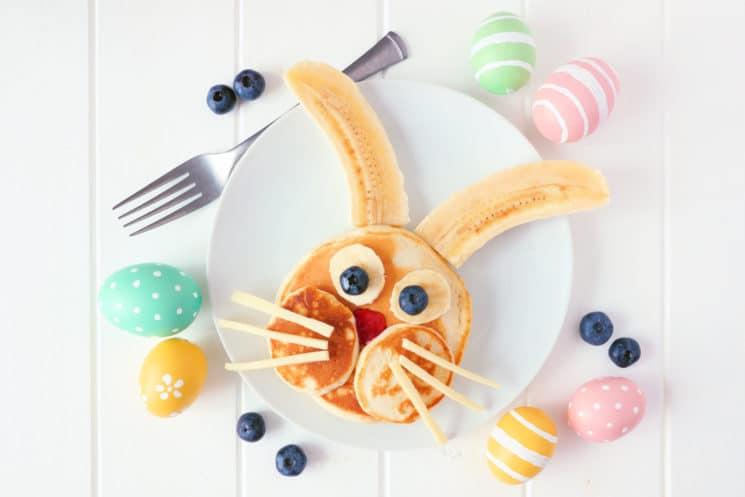 pancake shaped like a bunny with banana and blueberry eyes