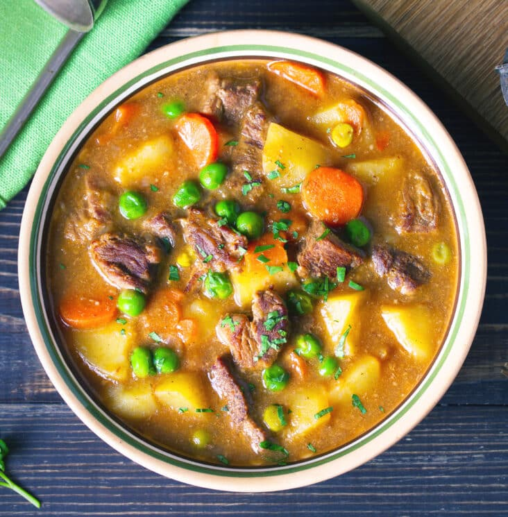 Instant Pot Vegetable Beef Soup with carrots, potatoes, beef, peas and in savory broth