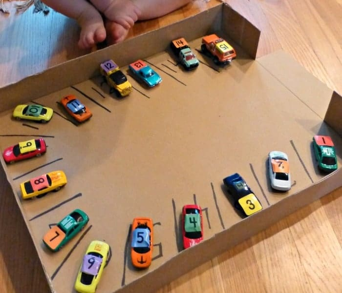 recycled cardboard box with diy matchbox car parking lot