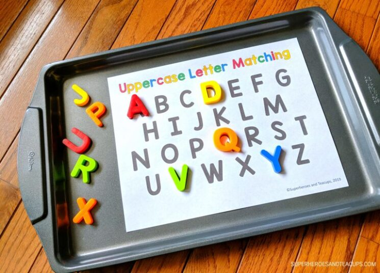 magnetic letters on cookie sheet make a good indoor activity for kids