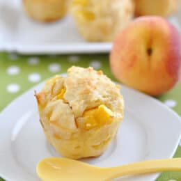 healthy cinnamon peach muffin with peaches in the background