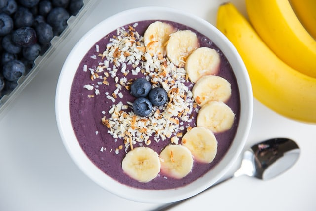 Blueberry smoothie bowl with bananas and toasted coconut on top