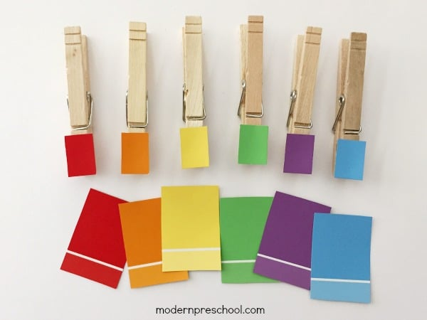 color matching game with paint chips taped to clothes pins