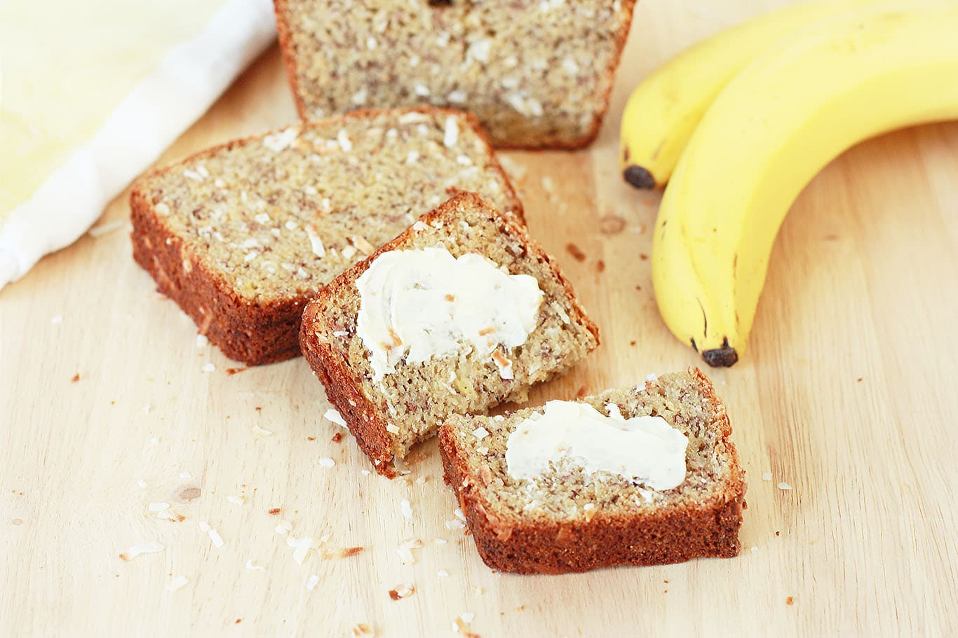 Coconut Banana Bread Sliced with butter on the slices
