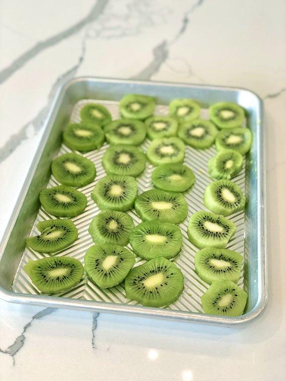 Sliced kiwis on a tray