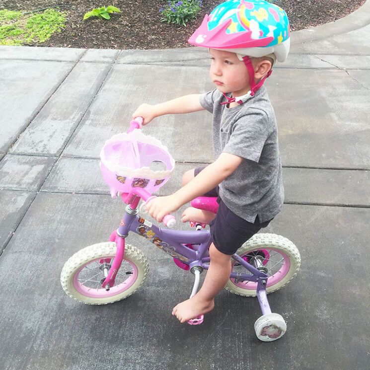 toddler on a bike with a helmet