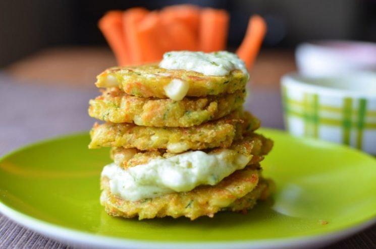 stack of zucchini pancakes with sauce