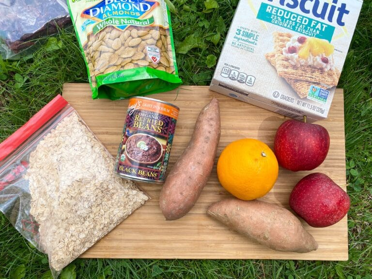 healthy camping foods on a cutting board