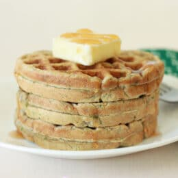 stack of 3 zucchini waffles on a plate