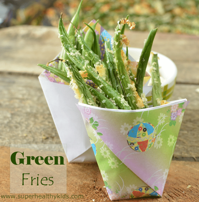 roasted green beans in a paper cup