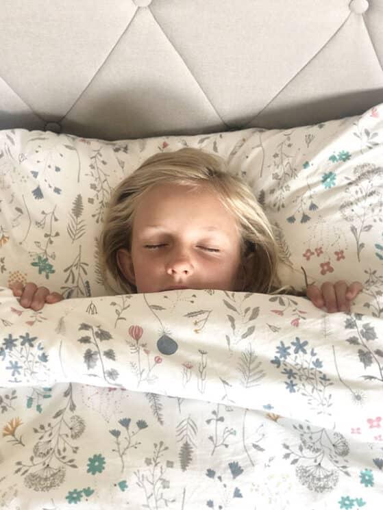 sleeping girl in flower covers
