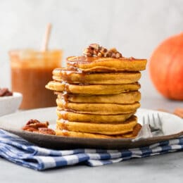 stack of whole grain pumpkin pancakes with caramel syrup