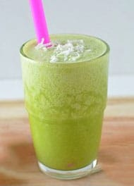 coconut green smoothie with a pink straw