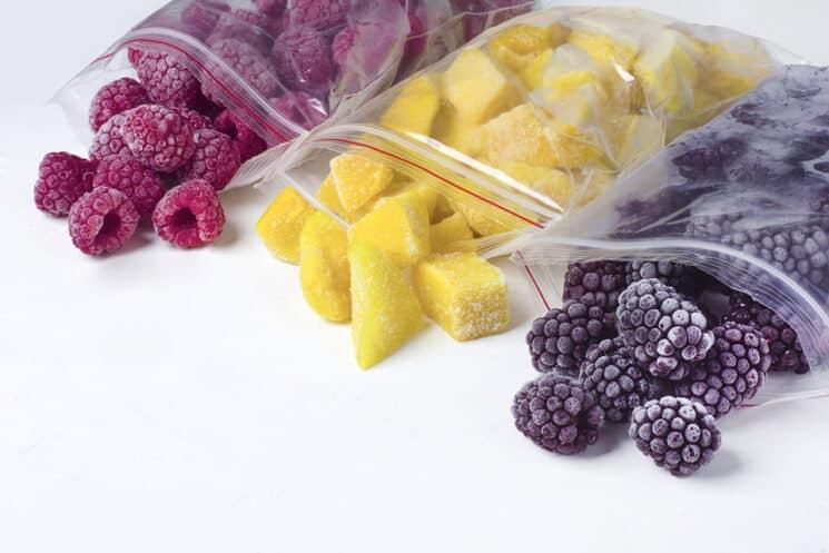 frozen raspberries, pineapple and blackberries in bags