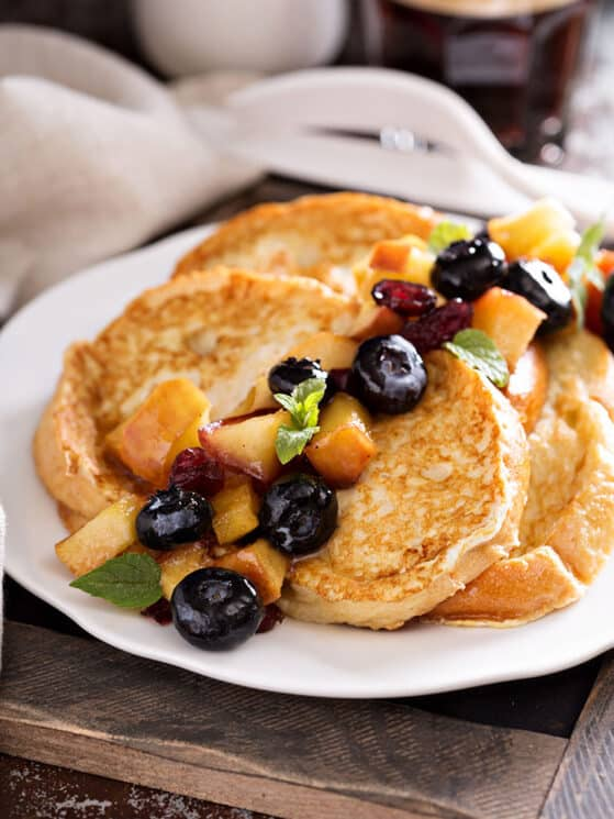 French toast with caramelized apple, blueberries and syrup